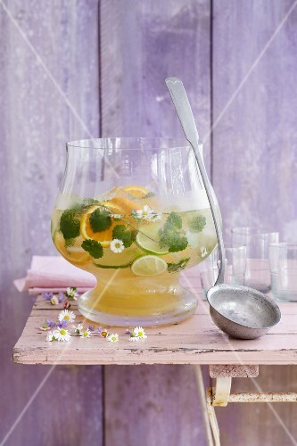 Herb punch with orange and lime slices