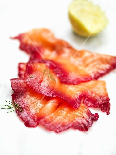 Slices of smoked salmon with dill and lemon