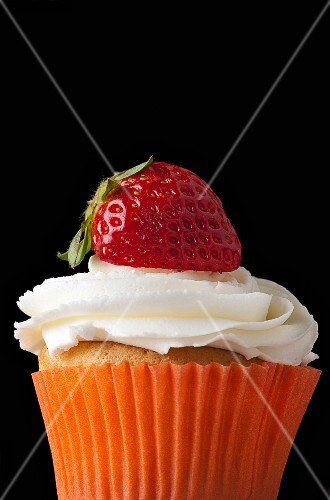 A strawberry cupcake topped with cream