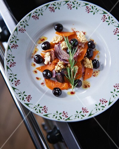 Roasted pumpkin with grapes, rosemary, onions and nuts