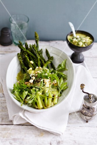 Baked green asparagus with wild herbs and capers