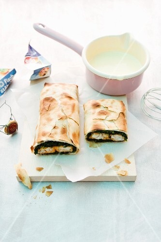 Fish finger and spinach strudel with champagne sabayon