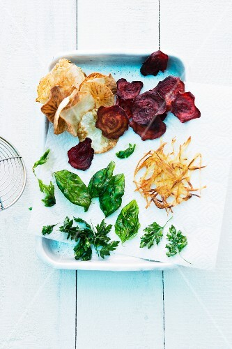 Fried herbs, fried vegetable chips and crispy potato lattice