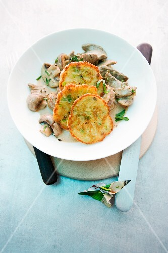 Veal with baked wild mushroom and leek blinis