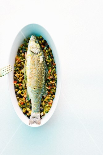 Oven-baked sea bass with vegetables
