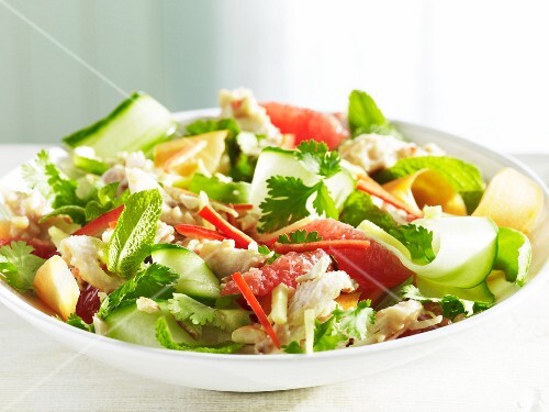 An oriental salad with cucumber, grapefruit and coriander