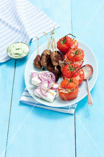 Kofta, feta with red onions and stuffed tomatoes