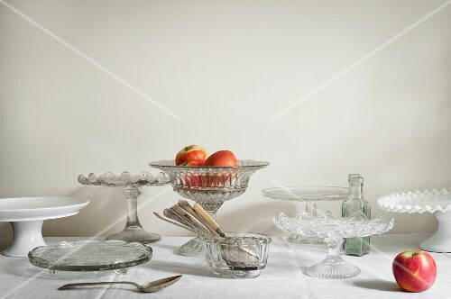 Various cake plates and stands with apples