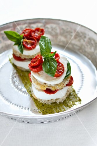 Bocconcini capresi (stacks of tomato and mozzarella, Italy)