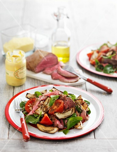 A beef, aubergine, spinach and tomato salad