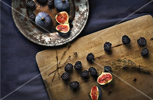 An arrangement of fresh figs and blackberries