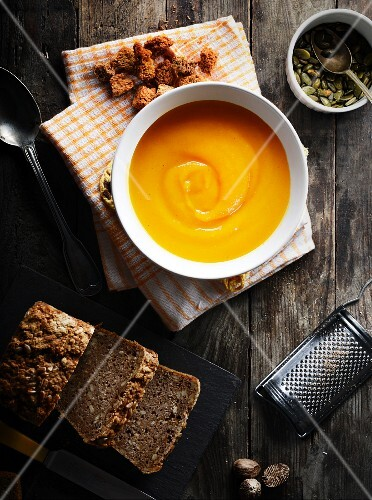 Butternut squash soup, croutons, pumpkin seeds and wholemeal bread
