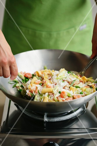 Fried rice being made in a wok