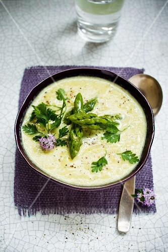 Green asparagus soup with chive flowers and chervil