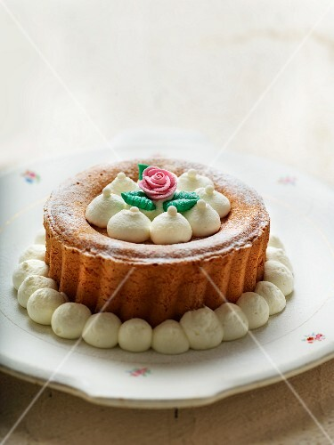 A festive Bundt cake decorated with cream and sugar roses
