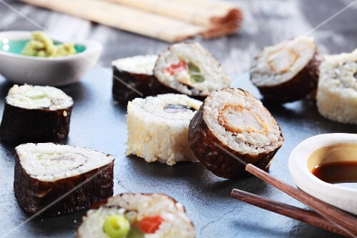 Various maki sushi with soy sauce and wasabi