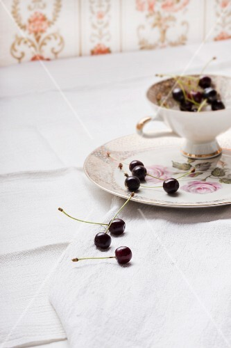 Cherries and a china cup