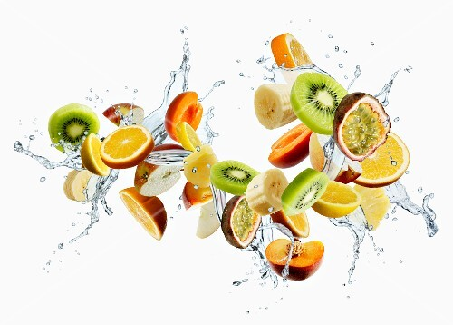 Various different fruits with a splash of water