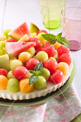 Cream cheese cake topped with colourful melon balls