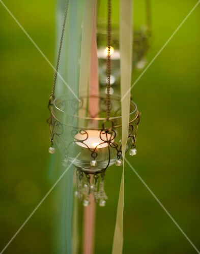 Tealight lanterns decorating garden