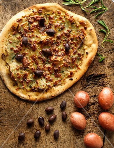Potato pizza with anchovies and olives