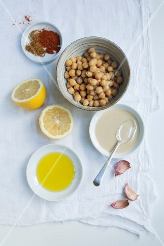 Ingredients for hummus: chickpeas, tahini, garlic, lemon, olive oil, paprika and cumin