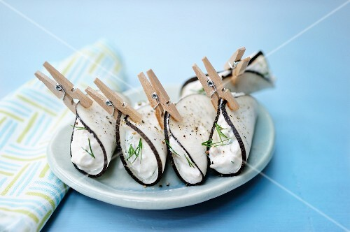 Black radish rolls filled with cream cheese and tuna