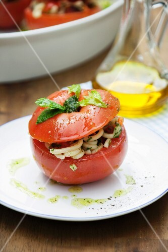 A tomato filled with pasta salad
