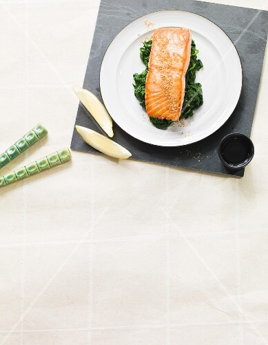 Salmon fillet with sesame on a bed of spinach