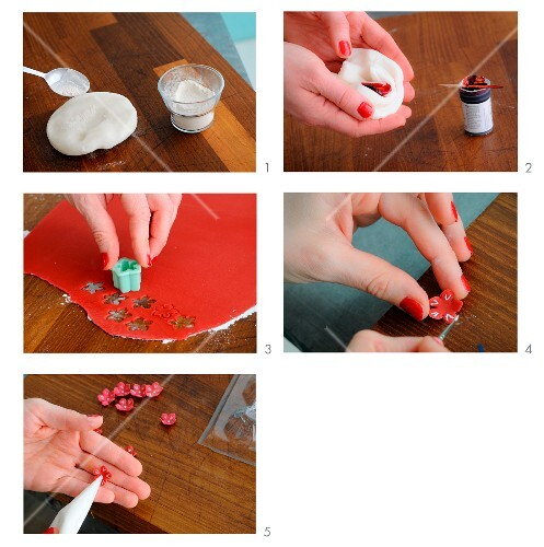 A sugar flower being made from fondant icing