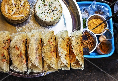 Dosa (fried rice flour crêpes and black lentils) at a street market in Rangoon, Myanmar
