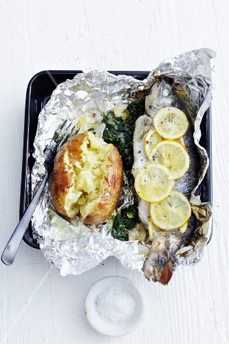 Foil-wrapped trout filled with spinach and a baked potato