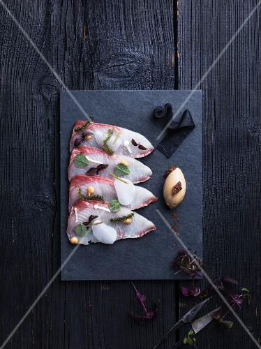 Raw hamachi on a fish platter