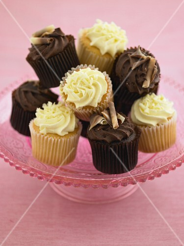 Lemon and chocolate cupcakes on a cake stand