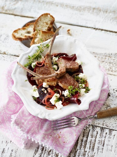 Lamb chops on a bed of beetroot