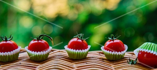 Tomatoes in praline cases on a basket