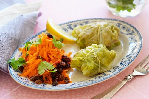 Savoy cabbage parcels filled with minced meat served with a raw carrot salad