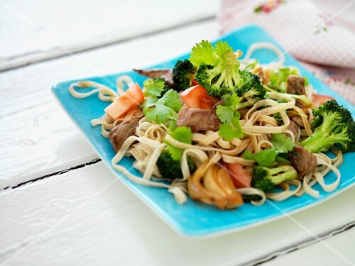 Noodle salad with broccoli, pork and vegetables