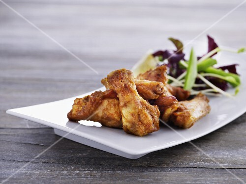 Chicken wings with a mixed leaf salad