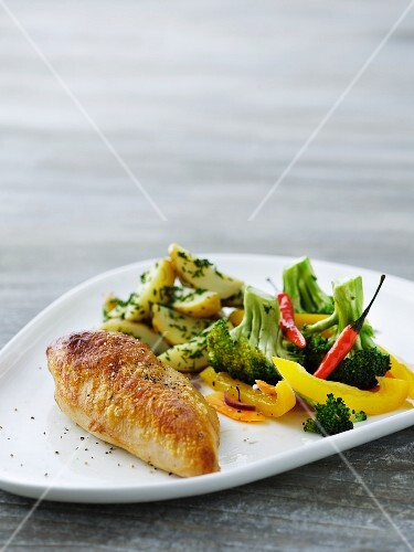 Chicken breast with vegetables and parsley potatoes