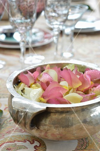 Silver dish of scented petals