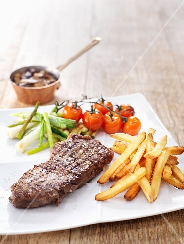 Grilled steak with chips and grilled vegetables