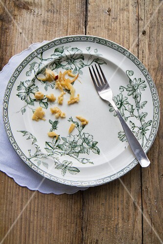 An empty plate with leftover Spätzle (soft egg noodles from Swabia)