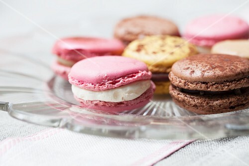 Various macaroons on a glass plate