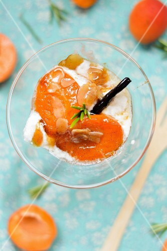 Roasted apricots with ice cream and slivered almonds