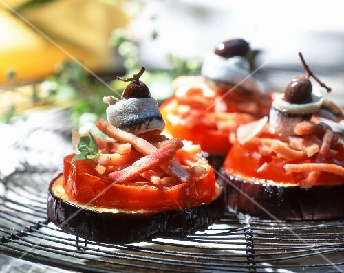Aubergines with tomatoes, bacon, anchovies and olives