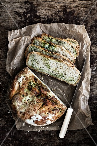Rustic herb bread on a piece of paper