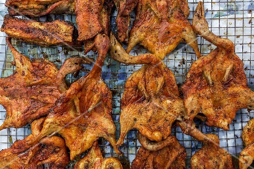 Grilled ducks at a market (Vientiane, Laos)