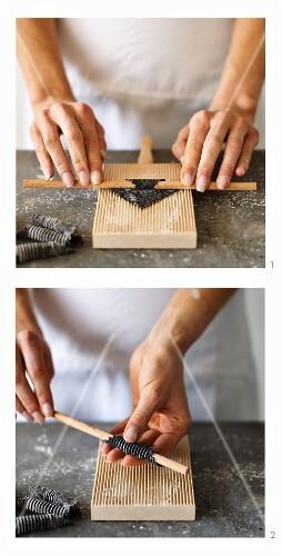 Squid garganelli being made