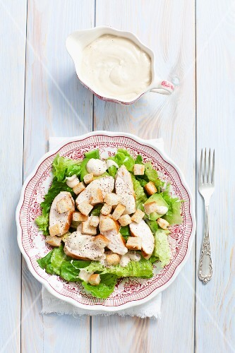 Caesar salad with avocado, chicken and croutons